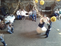 The groom twirling his mother