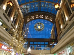 The giant wreath and the lights inside the mall making the sky outside lighter