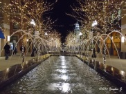 A walk by the fountain under festive lights.
