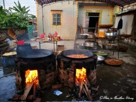 It's not everyday one gets to see large pots of food cooked using an open fire