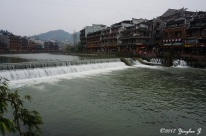 Water flowing from a dam in Phoenix City, Hunan, China